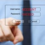 login screen transparent with finger pushing login with account hacked in username and password fields